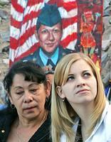 A portrait of Army Spc. Lori Piestewa, the first American servicewoman killed in the Iraq war, hangs in the background