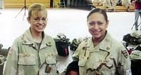Pfcs. Lori Piestewa, right, and Jessica Lynch pose at Fort Bliss, Tx., the day before their deployment to the Middle East in Feb