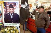 Archie Ortiz, junior vice commander for Native American Veterans of the Vietnam War, salutes a photo of Pfc. Lori Piestewa