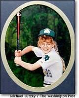 A childhood photo of Jessica stepping up to bat