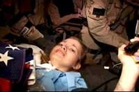 Jessica Lynch is carried by U.S. special forces as she is removed from the Saddam Hospital in Nasiryia.