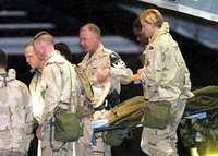 Jessica Lynch being escorted to Ramstein, Germany